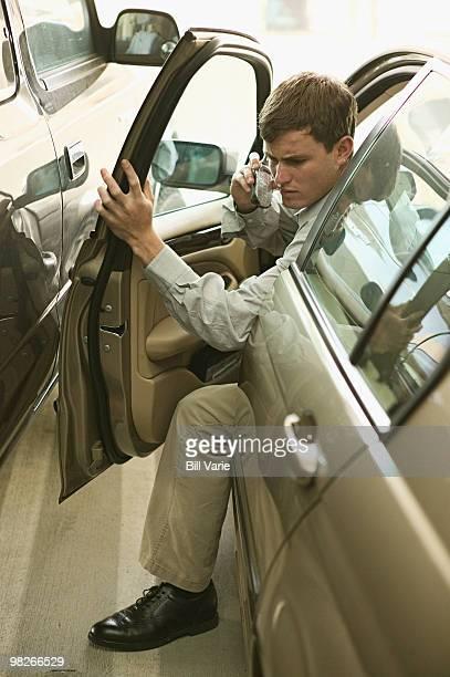 Man hitting vehicle with car door