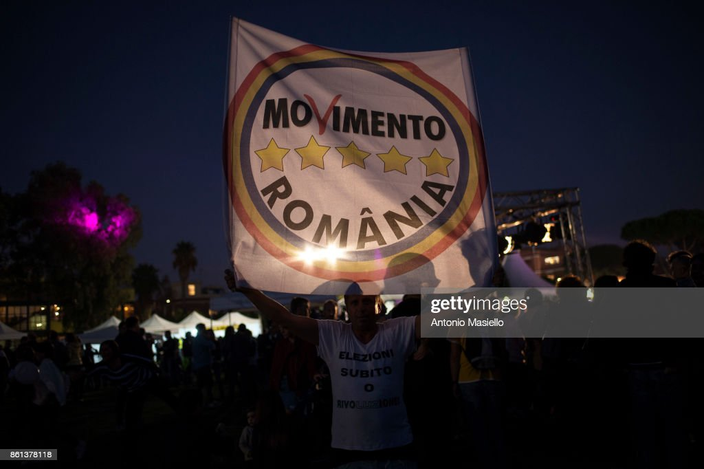 A man hold a flag during the political meeting organized by Five star movement for present the candidate for the presidency of the Lazio Region on October 14, 2017 in Marino, Roma, Italy.