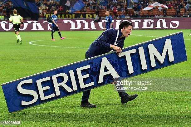 A man hold a placard reading 'Serie A Tim' before the Italian Serie A football match Inter Milan vs Atalanta at the San Siro Stadium in Milan on...