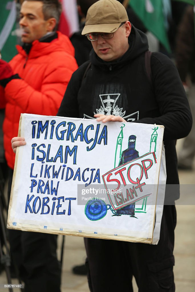 A man hold a poster that reads, 'Immigrants of Islam will liquidate women's right' during a demonstration against immigration and refugees coming to Europe in the old city sqaure in Warsaw. Hundreds of people gathered in Warsaw, Poland in the old city square protesting against what the organizers of the demonstration called the, Islamization of Europe. The National Movement (Ruch Narodowy) group and the Youth Movement (Modzie Wszechpolsk) group, both Polish right wing groups organized the march as a way to show, in the groups opinion that Poles and the rest of Europe are against allowing any immigrants and refugees from the Middle East to come to Europe. Group organizers warned people that police had told them no racist epitaphs would be tolerated, however, large groups of Polish men yelled racist slurs and epitaphs during the rally. The protest was part of a European-wide protest happening in other major cities across Europe including Dresden, Germany, Prague, Czech Republic, and Bratislava, Hungary.