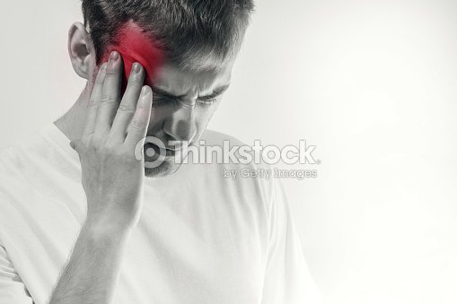 man hold his had and suffering from headache, pain, migraine, sad depressed isolated on white background, in a white t shirt : Stock Photo