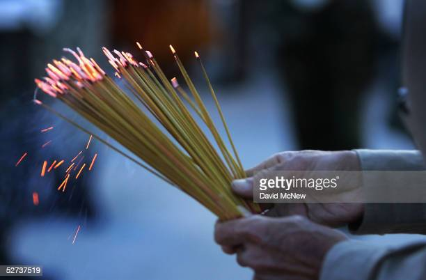 A man hold prayer incense on the eve of the 30th anniversary of the Fall of Saigon on April 29 2005 at the Vietnam War Memorial in Westminster...