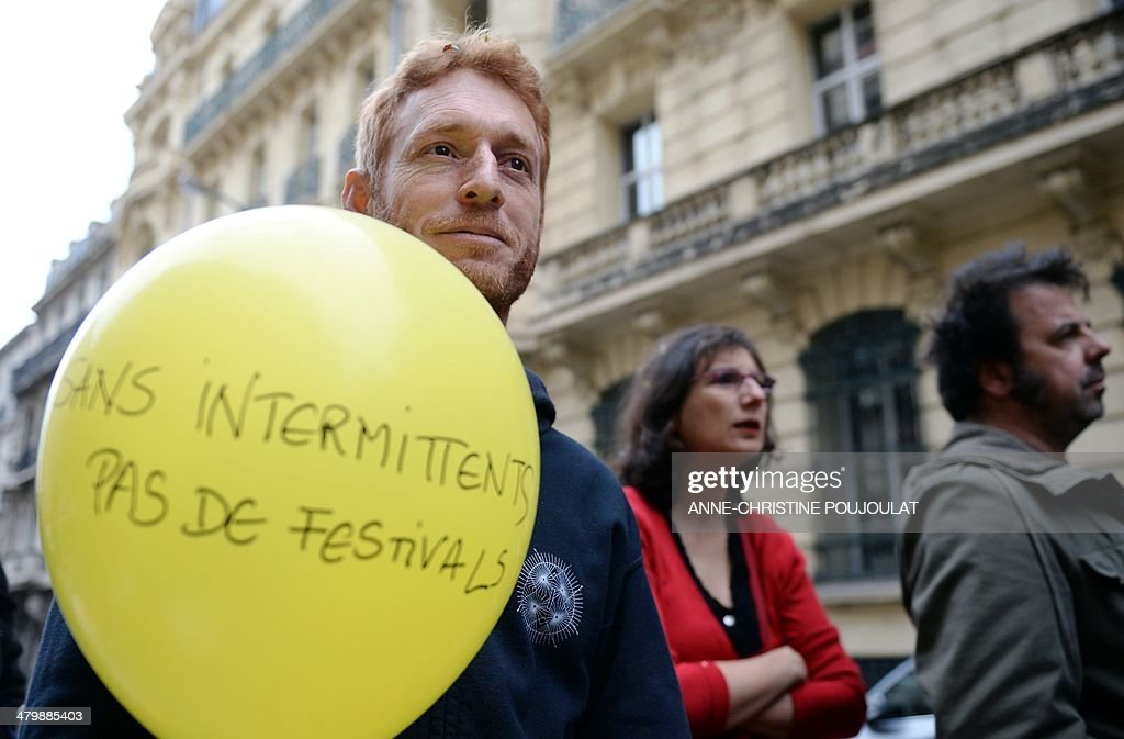 A man holding a balloon with the inscription 'No festivals without short-term contract entertainment industry workers' takes part to a demonstration of artists and technicians working in the entertainment industry on short-term contracts, on March 21, 2014 in Marseille, southern France. Unions and Medef (The French Employers Federation) representatives began on March 20, 2014 an ultimate negotiating session on the artists and performers' unemployment insurance system, as demonstrators continued to protest a planned reform of the rules regulating the unemployment benefits of short-term show business workers.