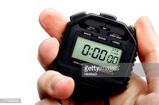 Man holding a black digital stopwatch set to zero
