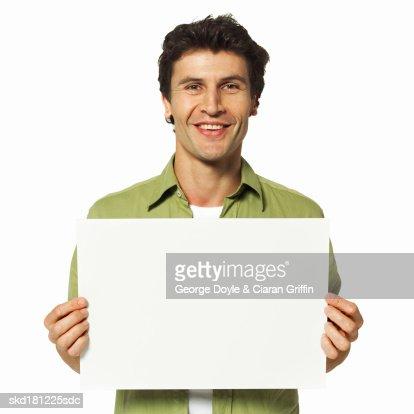 Man holding a blank card : Stock Photo