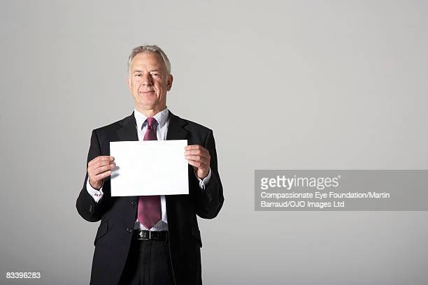 Man holding a blank piece of paper