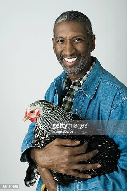 Man holding a chicken