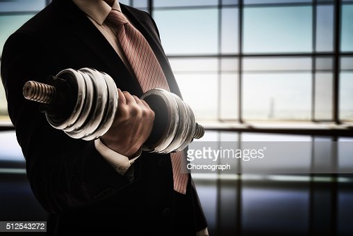 man holding a dumbbell : Stock Photo