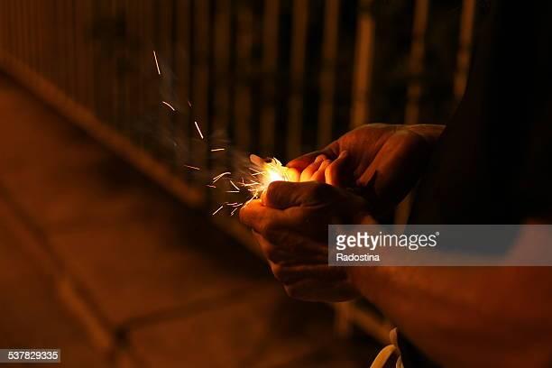 Man holding a firecracker