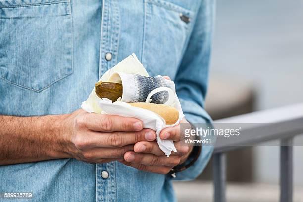 Man holding a fish sandwich
