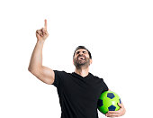 Man holding a football screaming in victory and joy