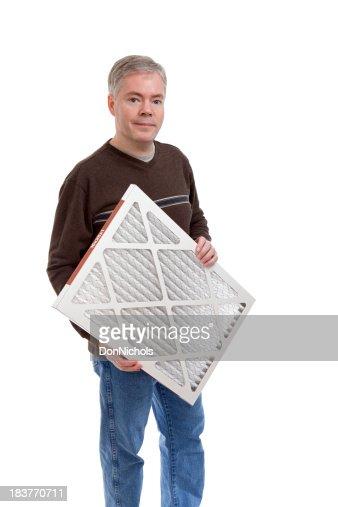 Man Holding a Furnace Air Filter