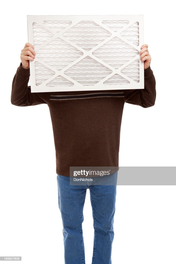 Man Holding a Furnace Air Filter : Stock Photo