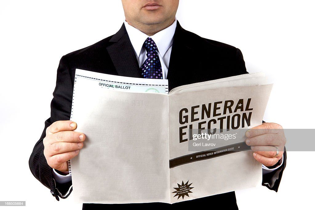 Man Holding A General Election Brochure And Ballot Stock Photo