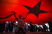 A man holding a giant Turkish national flag protests against Parallel State/Gulenist Terrorist Organization's failed military coup attempt at Taksim...