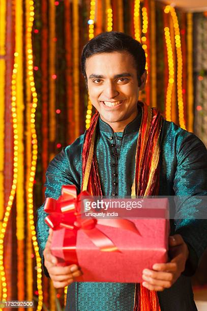 Man holding a gift on Diwali