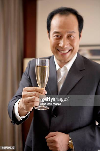 Man holding a glass of champagne