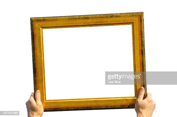 Mann hält eine goldene Frame.Add Ihre Message.Isolated