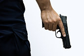 Man holding a gun in his hand with white background.