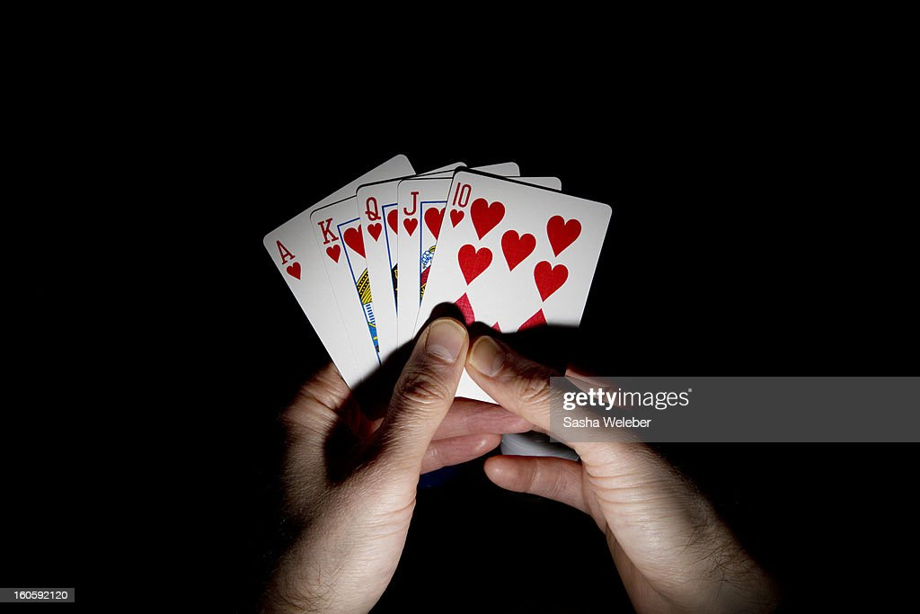 Man holding a hand of playing cards : Stock Photo
