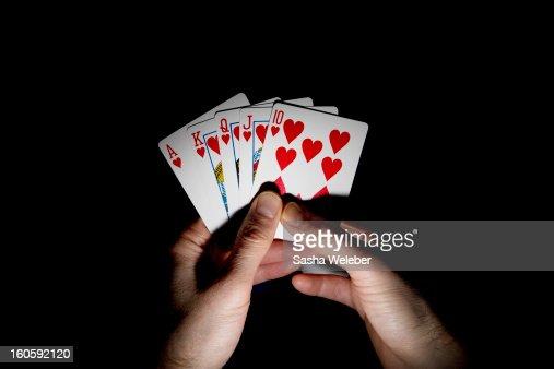 Man holding a hand of playing cards : Bildbanksbilder
