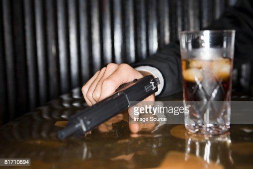 Man holding a handgun : Stock Photo