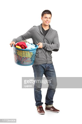 Man holding a laundry basket : Stock Photo