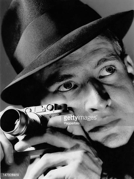A man holding a Leica 35mm compact camera circa 1945