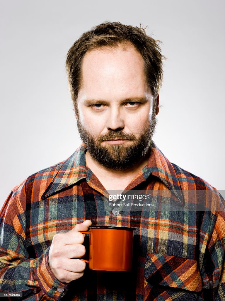 man holding a mug : Stock Photo