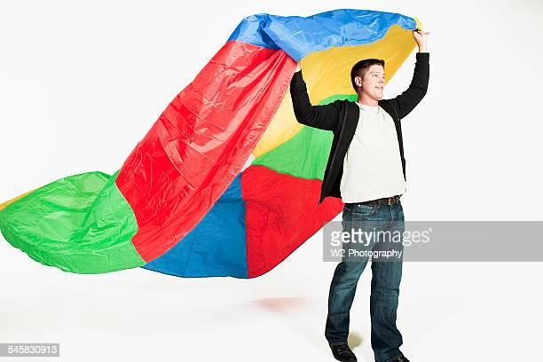Man holding a parachute