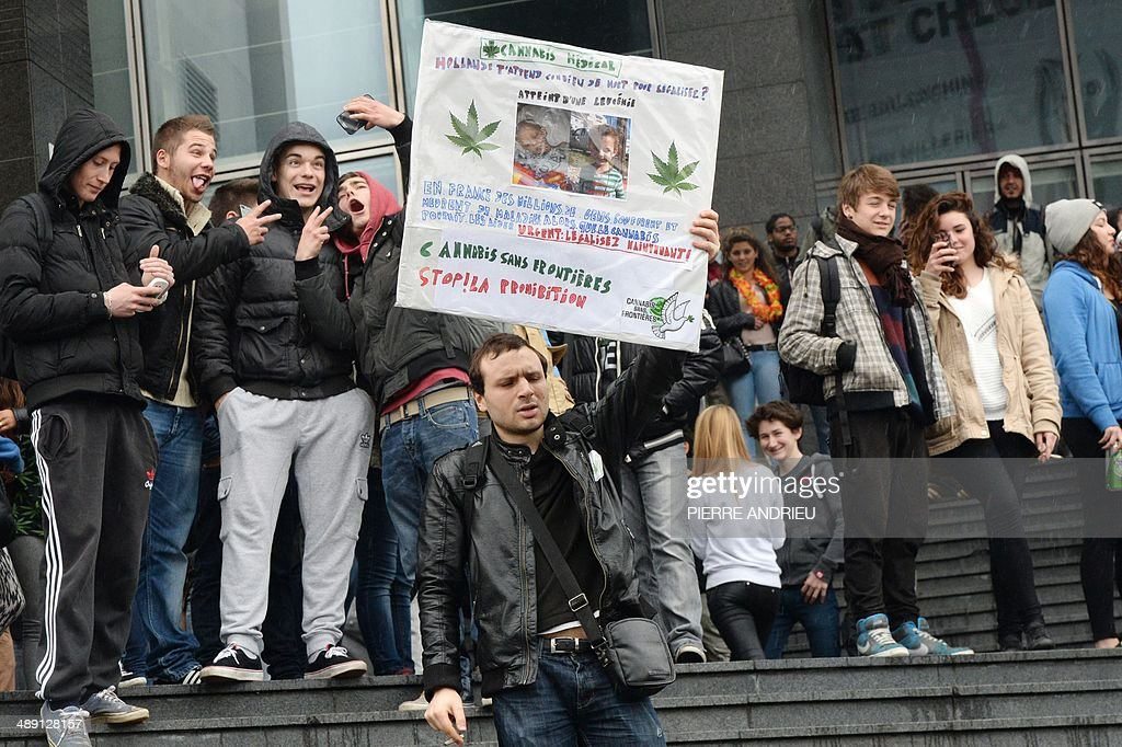 A man holding a placard and supporting the legalization of therapeutic cannabis takes part in a protest to call for the legalization of marijuana on May 10, 2014 in Paris. About 147 million people globally -- or about 2.5 percent of the population -- use cannabis, according to the World Health Organization.