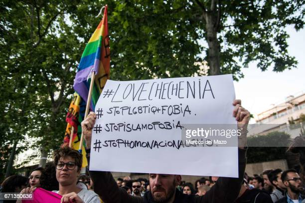 A man holding a placard during a protest against homosexual extermination in Chechnya in front of the Russian Embassy