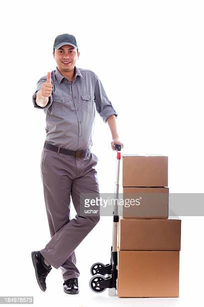 Man holding a push cart with boxes giving a thumbs up