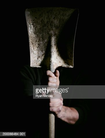 Man holding a shovel, focus on hands : Stock-Foto