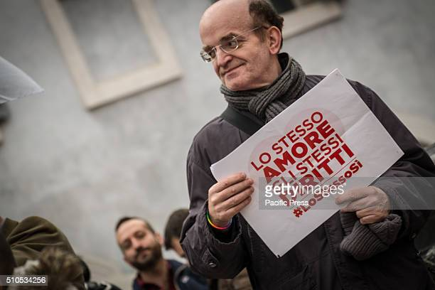A man holding a sign asking for rights to civil unions The Pantheon group kiss 'Love is never wrong' The Gay Center and other LGBT associations...