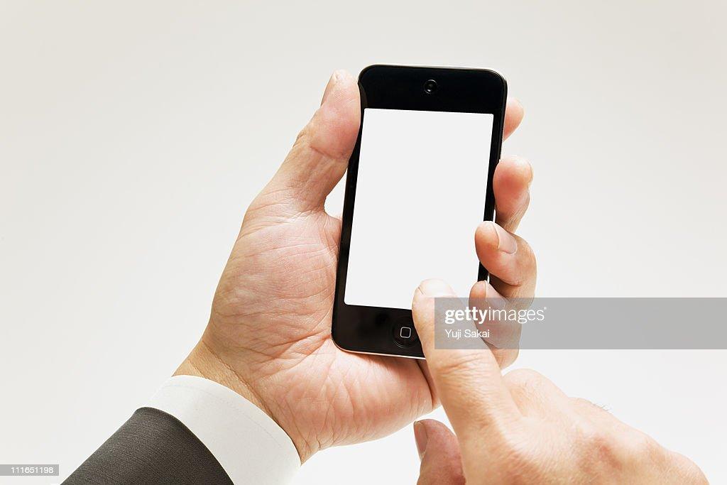 Man holding a smart phone : Stock Photo
