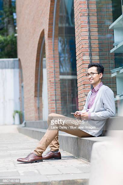 Man holding a smart phone