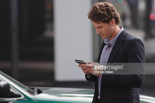 Man holding a smartphone in the street