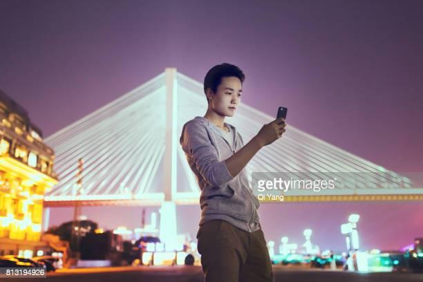 A man holding a smartphone, Shanghai, China