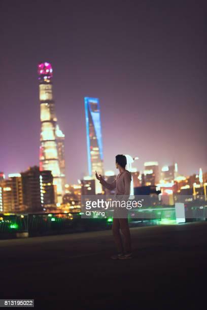 Man holding a smartphone, Shanghai, China