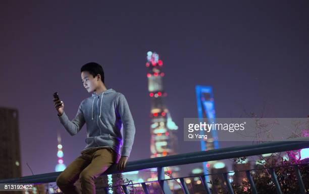 A man holding a smartphone,Shanghai,China