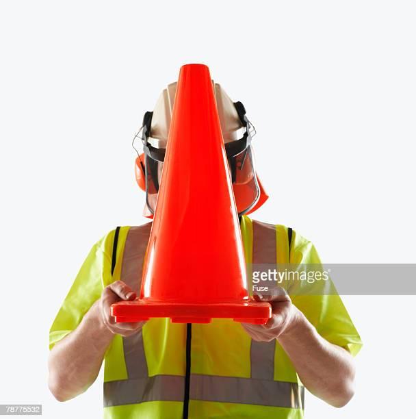Man Holding a Traffic Cone
