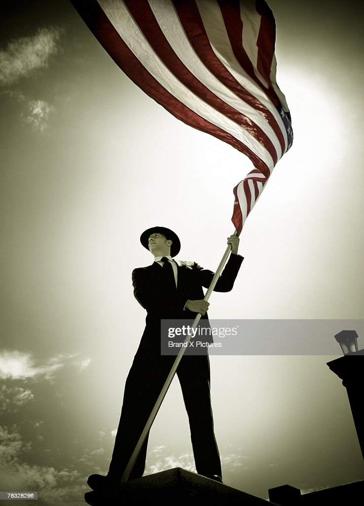 Man holding American flag : Stock Photo