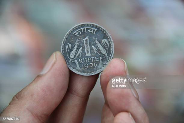 A man holding an Antique Rare Coin of 1976 in Kolkata India on May 3 2017