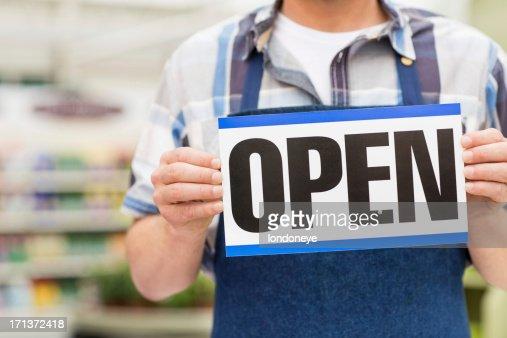Man Holding an Open Signboard : Stock Photo