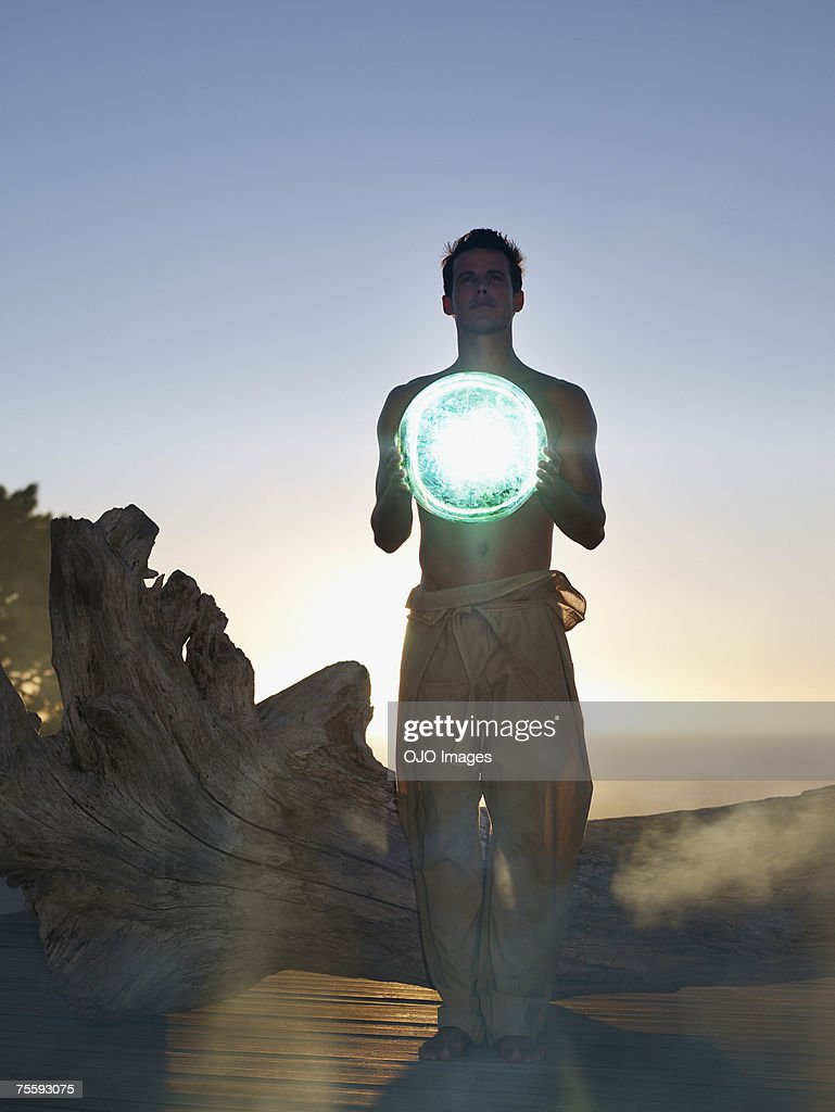 Man holding an orb : Stock Photo