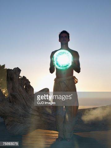 Man holding an orb : Stock Photo