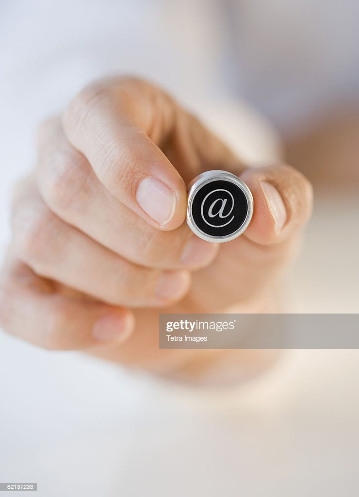 Man holding at symbol : Stock Photo