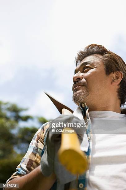 Man holding ax on shoulder