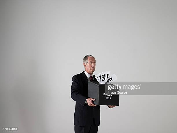 Man holding ballot box